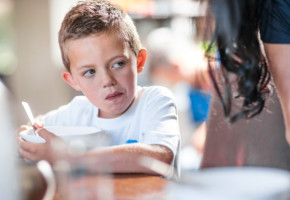 Cape Town, South Africa,Young boy eating breakfast at table